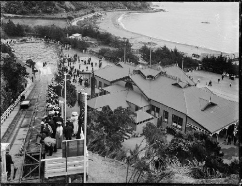 Looking down onto the Pavilion and water chute at Williams Park, Days Bay, Lower Hutt, Wellington, with the beachfront at the top right of the image. Photograph taken ca 1910s by Sydney Charles Smith.  S C Smith Collection Reference number: 1/1-022709-G Permission of the Alexander Turnbull Library, Wellington, New Zealand, must be obtained before any re-use of this image.
