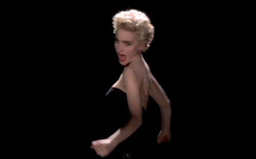 """Toned arms and boofy hair in """"Papa Don't Preach"""""""
